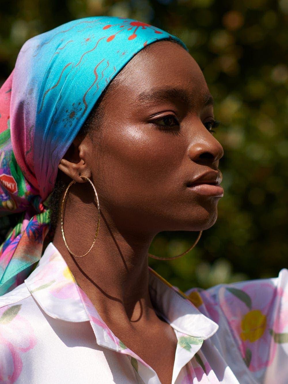 beautiful portrait of stunning dark skinned model wearing vibrant head scarf