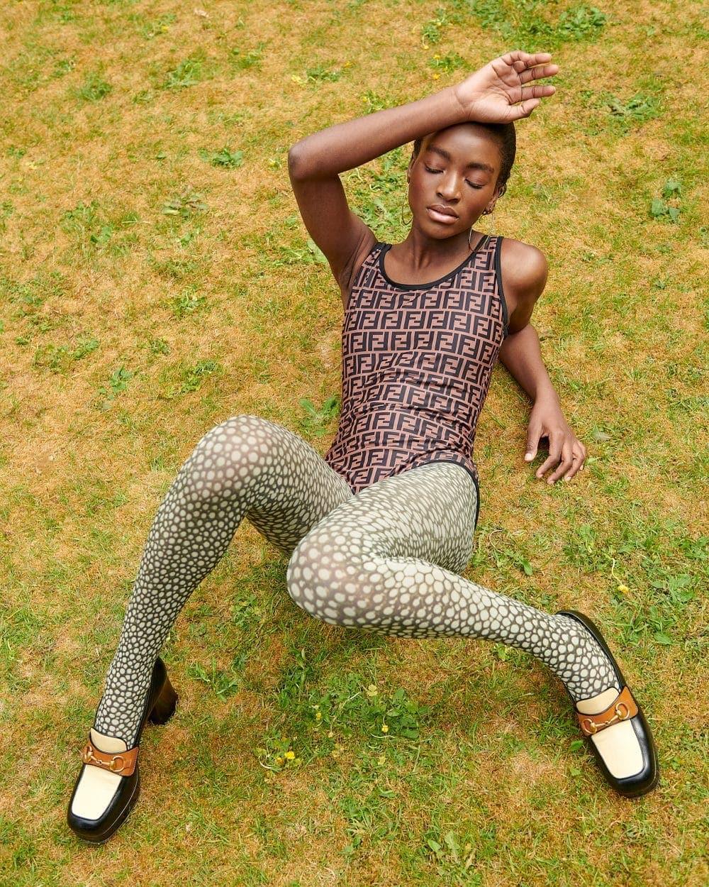 Model wears Fendi bodysuit and shoes